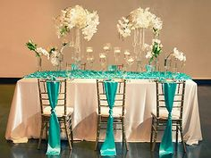 A teal and ivory tablescape by Posh Peony Event Design.