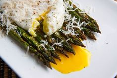 ROASTED ASPARAGUS WITH POACHED EGG  Ingredients:  1 pound thick asparagus (trimmed)  4 eggs  salt and pepper to taste  parmigiano reggiano to taste (grated, optional)  balsamic vinegar to taste (optional)