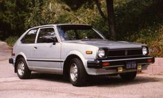 1980 honda civic. This really was a GREAT car. Mine was brown. And filthy/dilapidated. taught my sister to drive it in the hay field when she was like 6! It was a 5 speed too!