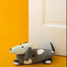 Doggy Doorstopper This friendly spotted stone dachshund guards your child's bedroom -- by propping its door open.