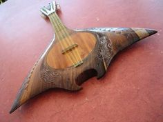 Tahitian Ukulele - This looks like it could be a mandolin because of the 8 strings in clusters of two, but I would love to play it regardless