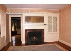 beautiful built-in china cabinet - love the glass and gingerbread doors