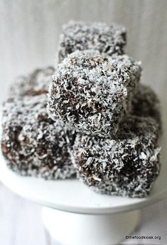 Australian Lamingtons (Eggless) is a dessert made with sponge cake cut into squares, dipped in chocolate sauce and rolled in a bed of desiccated coconut. Eggless Recipes, Eggless Baking, Cake Recipes, Dessert Recipes, Eggless Desserts, Baking Recipes, Easy Desserts, Delicious Desserts, Australian Desserts