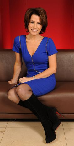 Natasha Kaplinsky in black sheer pantyhose, long black heeled boots and electric blue tight dress with zip-up sleeves | Pantyhose Party