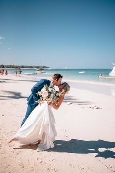 Beach Wedding Photos beach dip and kiss wedding photo pose - Who doesn't want to be on a white sand beach right now? Let's all make ourselves a Mai Tai and imagine ourselves there while we check out this gorgeous day! Beach Wedding Bouquets, Beach Theme Wedding Invitations, Beach Wedding Centerpieces, Beach Wedding Locations, Beach Wedding Photos, Wedding Photoshoot, Sunset Beach Weddings, Wedding Pictures, Professional Wedding Photography