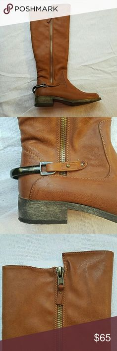 Riding Boots Man-made riding boots. Worn once. Has gold zipper detail. Also has a medal strap detail on back of boot. Coconuts Shoes Winter & Rain Boots