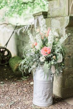Milk Churn Floral Arrangement - Katy Melling Photography | Blush Family Wedding at Old Horton Grange Farm in Yorkshire