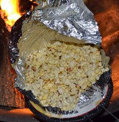 Jiffy Pop popcorn over a camp fire. More camping food ideas  http://thegardeningcook.com/camping-foods/