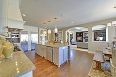 Like the kitchen and outside look. Layout isn't bad, but MB is upstairs. Don't like the four car garage facing street.