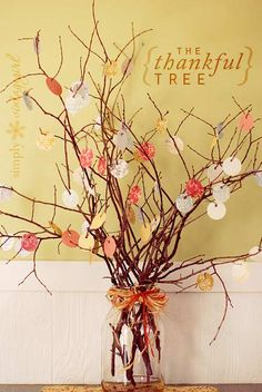 """""""The Thankful Tree""""... we love it. Branches adorned with colorful gift tags add much needed color and pattern. You can easily create your own """"vintage gift tags"""" by cutting circles out of decorative paper."""