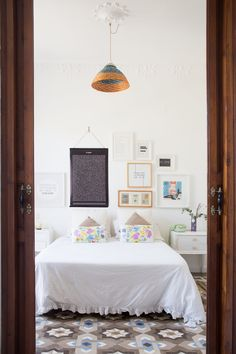 Gravity Home: Bedroom with beautiful floor tiles in a light Spanish home