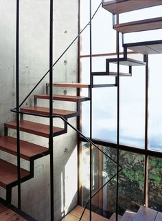 Sticotti residence staircase and concrete wall embedded with PVC tubes and bare lightbulbs