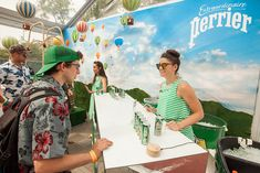 Perrier: At a bar, staffers in green-and-white striped outfits offered samples of the sparkling water.