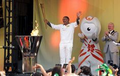 Proud: Daley Thompson beamed as he lit the Olympic couldron as the final torchbearer of the day at Alexandra Palace - he is the 8,000th person to carry the Olympic flame since his fellow gold medalist Ben Ainslie began the relay at Land's End on 19th May
