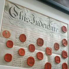 A selection of my antique wax seals, framed on a Victorian indenture