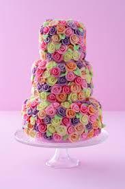 Sweet wedding cake with pastel/ice cream coloured roses.