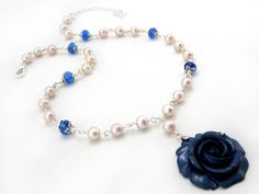 Winter Bloom $27.00 - Ladies freshwater pearl necklace. Freshwater pearls, Swarovski crystal beads, resin flower pendant, and Tibet silver on silver plated wire.