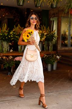 Dressy summer outfit idea. White lace midi dress paired with brown strappy sandals and a Chloe bag.