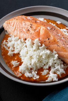NYT Cooking: In 2008, The New York Times asked the chef Eric Ripert of the celebrated restaurant Le Bernardin to dream up a meal that leaned heavily on products from a Jack's 99-Cent Store. Mr. Ripert tackled the assignment with ingenuity and aplomb, creating dishes like this baked salmon with creamy jasmine rice and a tomato sauce, which uses canned coconut milk in both the rice and sauce.