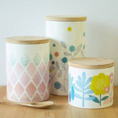 Beautiful Scandinavian style canisters with a fresh design.These sturdy ceramic canisters are perfect storage for tea, coffee, sugar, hot chocolate, marshmallows, you name it! We adore their mismatched design and tight fitting lid. Three designs to pick from, each in a different size. We also sell matching ceramic mugs, check our other listings. We wouldn't recommend washing these in the dishwasher.Ceramic and woodDiameter: 10 cm Height: Small - 11.5cm, Medium 14.5cm, Large 17.5cm