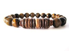 Beaded stretch bracelet for men featuring 10mm tiger eye beads, coconut shell beads and antiqued copper accent beads (accent beads may vary