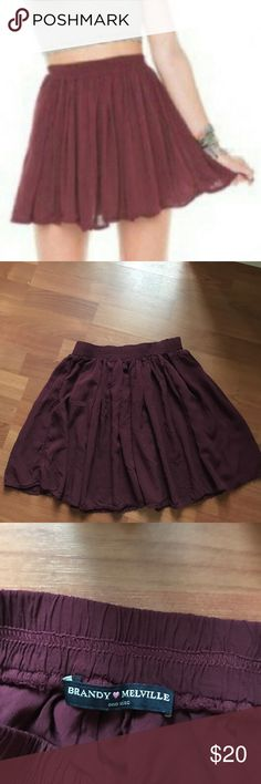 Brandy Melville Burgundy Skirt Super cute, simple, and versatile circle skirt from Brandy Melville in a rich burgundy color. Layered and flowy. Worn once ! size: OS Brandy Melville Skirts Circle & Skater