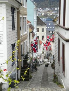 Norwegian flags attached to the buildings in the Norwegian streets. //Norway. http://www.lonelyplanet.com/norway