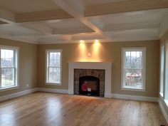 Coffered ceiling and custom wood mantle.  Stone fireplace.  Gas fireplace insert.