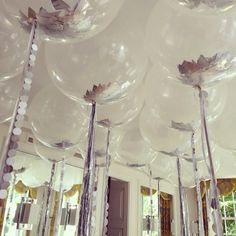 Balloon Ceiling- Giant latex balloons filled with silver confetti with silver and white streamer balloon strings.