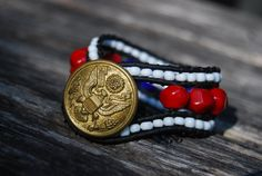 Patriotic Team USA Wrapped Leather Bracelet with Red Coral & Vintage Military Uniform Button. $29.00, via Etsy.