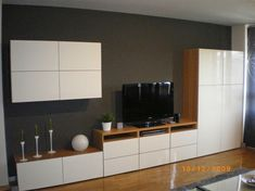 Like the combination of timber and white lacquer. Great system for dining room storage in a different configuration.