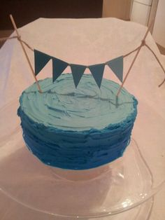 My husbands birthday cake. Ombre blue with bunting.