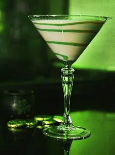The Loopy Leprechaun 1 part Three Olives Loopy Vodka 2 parts Irish Cream Liqueur Green Colored Simple Syrup (optional for swirling around the inside of the glass) Serve chilled as a shot or martini! Party Drinks, Fun Drinks, Yummy Drinks, Alcoholic Drinks, Beverages, Green Cocktails, Cocktail Drinks, Cocktail Recipes, Leprechaun