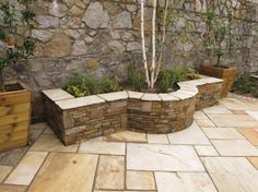 raised planter constructed of natural stone all mortared in place