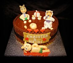 Mud cake with fondant sheep, fondant pig and lovesick fondant pig in front