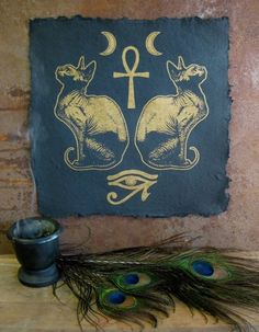 Spirit ~ Twin moons, ankh, twin Bastets, udjat (eye of Horus).  Gorgeous altar.  ['found' or faux feather version]