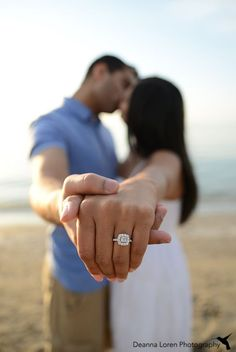 Engagement picture ideas on the beach, showing off the ring | Edgewater Beach, Cleveland, OH | Nirali Ankit Engagement Pictures |Deanna Loren Photography