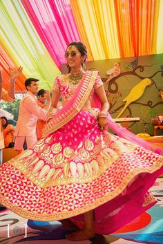 OMG! This bride's pink and gold lehanga is just stunning!!!! #IndianWedding #fashion #bridal #inspiration #happy #twirlingBride | Photo via - @DhanikaChoksi photography | Curated by #WittyVows - The ultimate guide for the Indian Bride | www.wittyvows.com