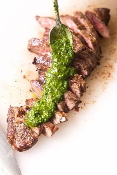 Skirt steak with chimichurri sauce - a delicious (and affordable!) steak dinner topped with a cilantro parsley sauce. (paleo, whole30, gluten free, low carb)