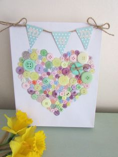 Mother's Day is just around the corner. I am obsessed with all things pastel and hearts at the moment and set about making an easy-to-make button canvas.