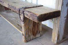 Wonderful horse shoe and metal strap detail on a gorgeous distressed wood bench.....