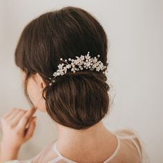 Hazel crystal and pearl embellished hair vine by Halo and Co A curved vine of blossoms, pearly sprigs and crystal buds captures light and attention to perfection.