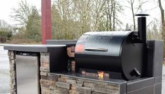 Outdoor kitchen for the Traeger pellet grill! We custom build for any grill or any area! Call today for your custom quote today Sunset Traeger Smoker, Traeger Grills, Grill Stone, Oasis Pool, Wood Pellet Grills, Backyard Kitchen, Outside Patio, Built In Grill, Grill Design
