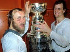 Former center Butch Goring celebrates the third consecutive Stanley Cup in 1982 after sweeping the Vancouver Canucks in four games. Goring won the Conn Smythe Trophy the previous season. Stanley Cup Finals, New York Islanders, Season Ticket, Vancouver Canucks, Mason Jar Wine Glass, The Good Old Days, Cool Photos, The 100, Ice Hockey