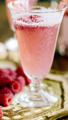 Champagne spritzer cocktail with raspberries