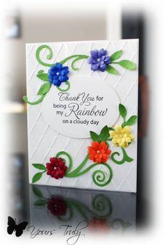 Bright cheery card. Love the flowers and the diamond embossed background.