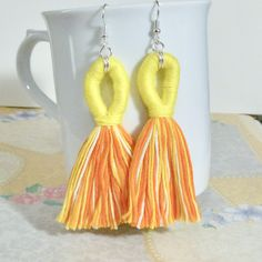 Shades of Orange and Yellow Looped Tassel Earrings by DolphinMoonCreations #etsyjewelry #tasselearrings #tasseljewelry