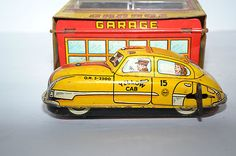 Vintage Marx Lubritorium Car Wash Garage with Skyview Yellow Cab Tin Litho |