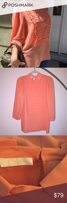 "Chloe coral silk blouse pintuck bib flawless 42 12 My poor petite model was swimming in this top but look how cute! Like new condition, keyhole one button closure. 3/4 sleeves. Pintuck cascading bib detail. 100% silk. 14"" shoulder to shoulder, 38"" bust, 22"" sleeve, 28"" length. For comparison, model is size 0, 5'6"" and waify af. Chloe Tops Blouses"