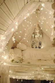 Check out the link! 15 ideas to hang Christmas lights in a bedroom! I love Christmas lights! Had them in my room as a teenager. Ava has flower lights in her room now. Would love to add them to our canopy decor design